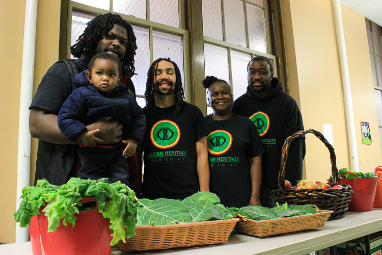 Alex Wright of the African Heritage Food Co-op, with his son and friends.