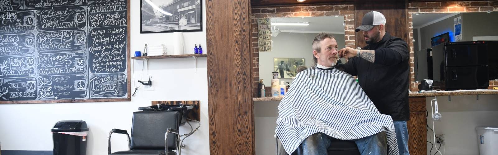 Rock Boyz Barbershop is full of neighborhood history, including old street signs and photographs from the Old First Ward. <span class='image-credits'>Jessica Brant</span>
