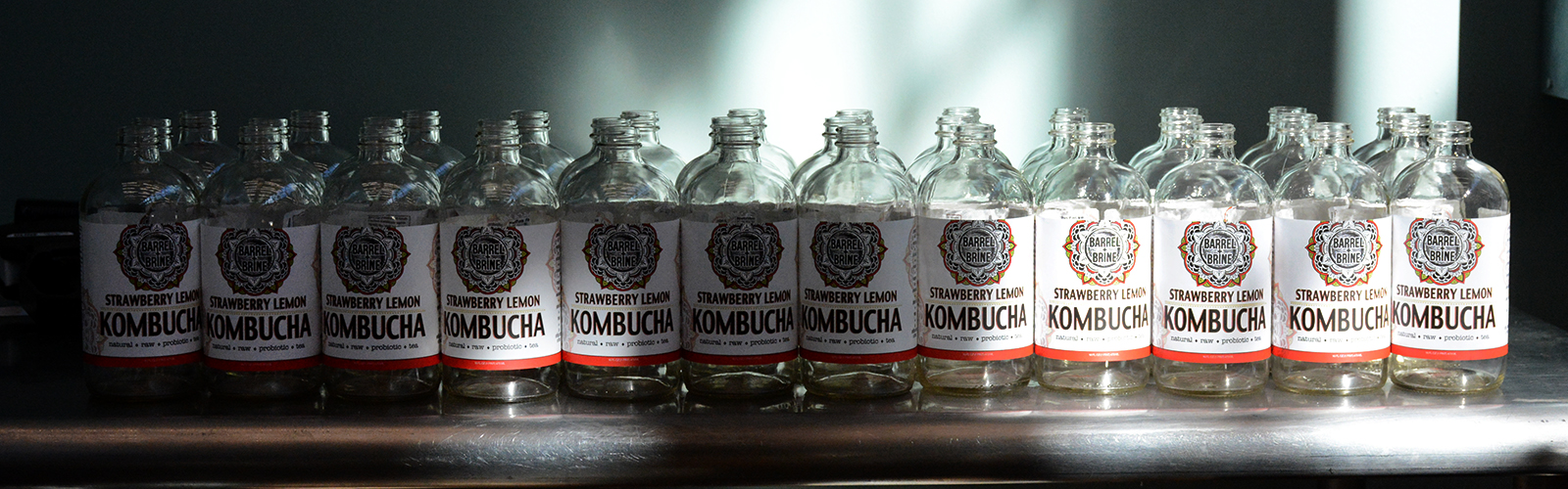 Bottles waiting to be filled with strawberry lemon kombucha at Barrel + Brine, 155 Chandler St., Suite # 3, Buffalo, N.Y.