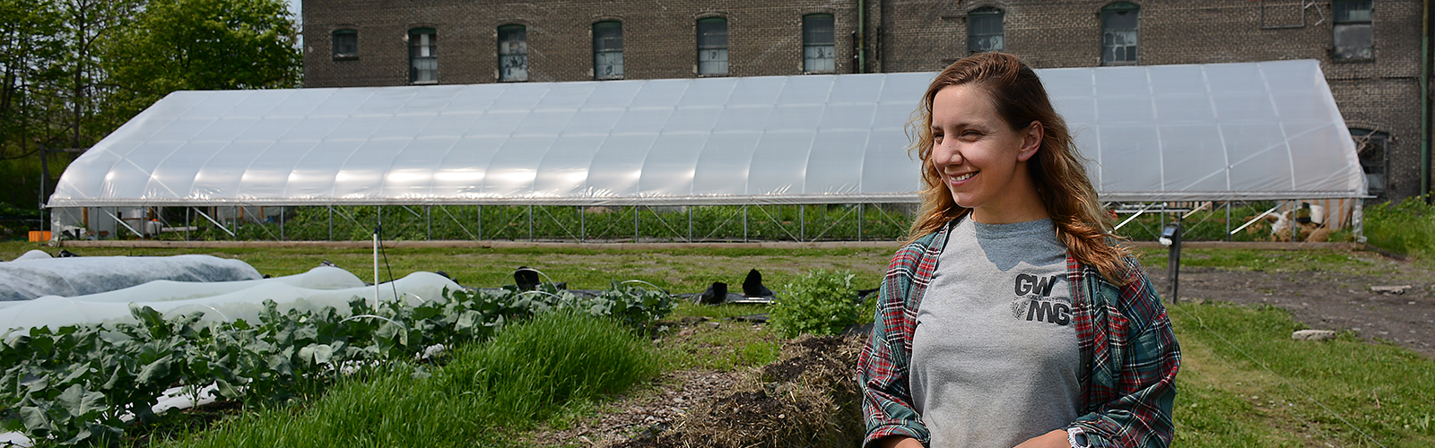 Groundwork Market Garden co-owner Mayda Pozantides stands in a field of freshly planted crops at 1698 Genesee St., in Buffalo.