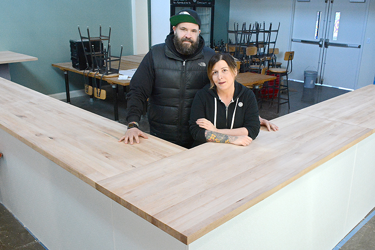 RJ and Lindsey Marvin, owners of Barrel + Brine, stand in their soon-to-be-completed dining area at 155 Chandler St., in Buffalo, N.Y.