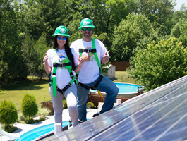 Alicia Uebelhoer and Tyler Uebelhoer of Buffalo Solar Solutions at work.