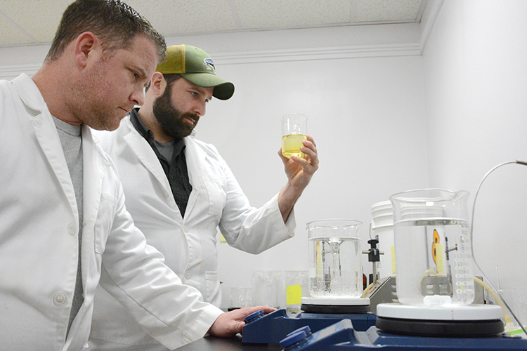 Mike Andrews and Justin Schultz blend CBD products in their laboratory at 1100 Military Rd. in Kenmore, N.Y.