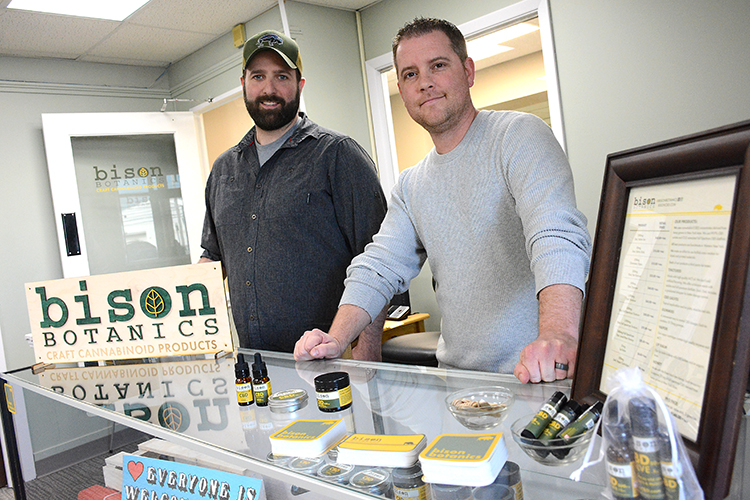 Bison Botanics owners Mike Andrews and Justin Schultz at the counter of their walk-in shop.