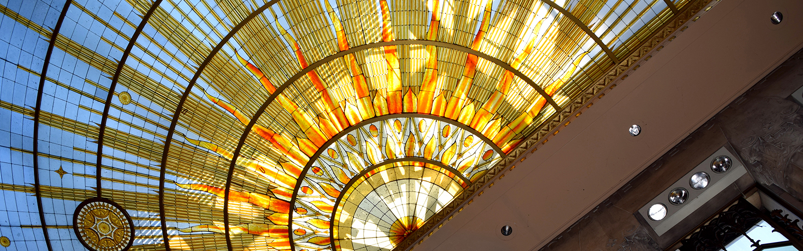 Buffalo City Hall's Common Council Chamber features a stained glass sunburst ceiling that was inspired by Iroquois art. <span class='image-credits'>Casi Hall</span>