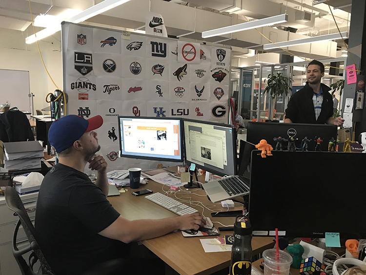 Employees at work at CoachMePlus