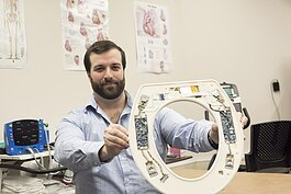 Nicholas Conn, CEO of Heart Health Intelligence, with his invention, the Heart Seat.