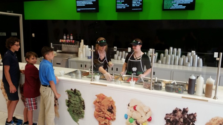 Children line up for a scoop of cookie dough.