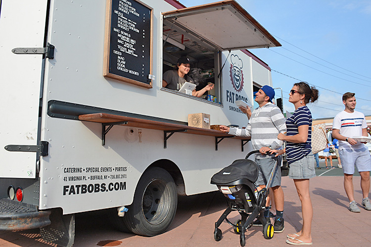 Patrons order food from Fat Bob's food truck, which specializes in Southern BBQ and its famous mac and cheese.