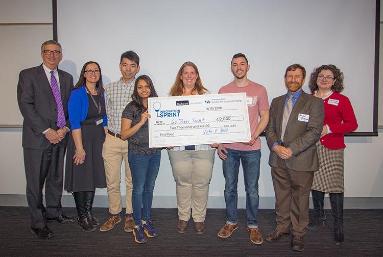 Team members from Go Dress Yourself (starting third from left) Wei Lin, Harsha Kosta, Kim Persons, and Joseph Whaley earned first-place honors, and a check for $2,000, as the winners of UB's recent innovation challenge.