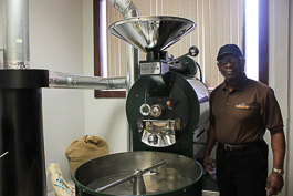 Larry Stitts showcases the Ozturk roaster at Golden Cup Coffee.