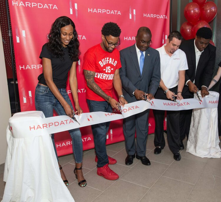 HarpData CEO and founder Ivory Robinson cuts the ribbon with Buffalo Mayor Byron Brown.