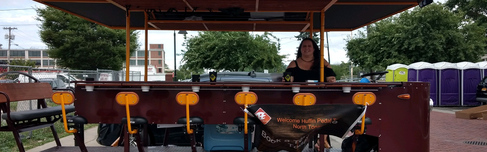 Sarah Ivory, owner of Huffin Pedal Tours, Western New York's newest Pedal Pub, offers passengers a different way to enjoy North Tonawanda and the Erie Canal. <span class='image-credits'>Huffin Pedal Tours</span>