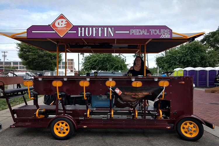 Sarah Ivory, owner of Huffin Pedal Tours, takes passengers to the pubs and restaurants in North Tonawanda during customized tours on her Pedal Pub.