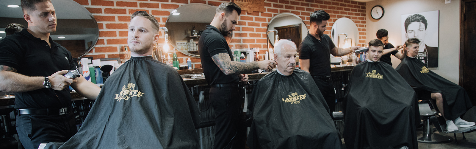 "At Jonny the Barber, the clients and their barbers are a ""brotherhood."" <span class='image-credits'>Jackson Zimmerman </span>"