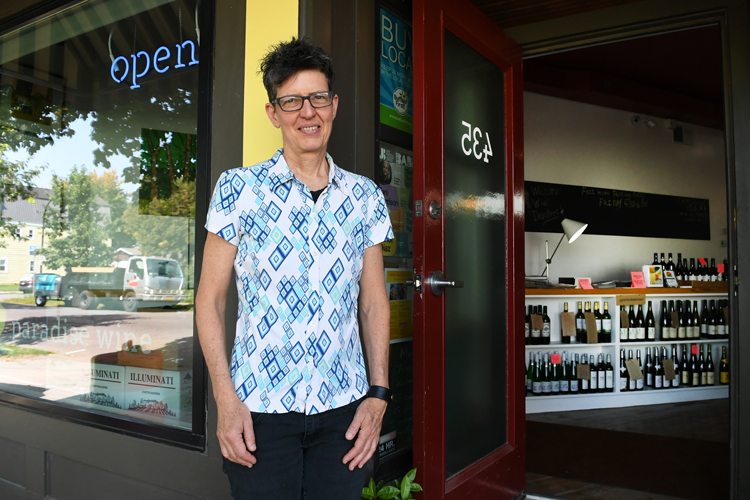 Paula Paradise, co-owner of Paradise Wine, in front of the west side business.