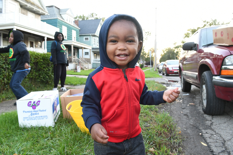 Baby James Wright, age 1.5, helps sell fruit during Slow Roll