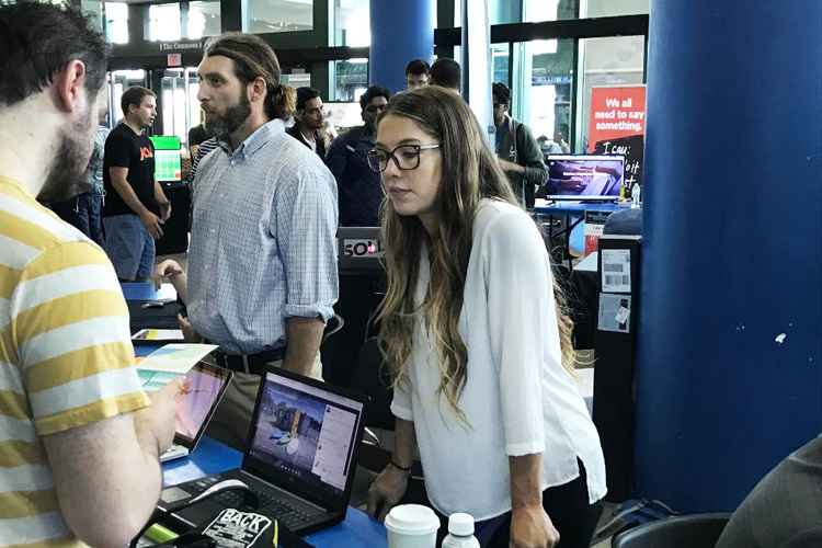 Kevin and Christian Cullen of Stand-Up Paddle Boards (SUP) Erie Adventures speak to guests at the University at Buffalo Entrepreneurs Festival Thursday, Sept. 14 at the UB Student Union.