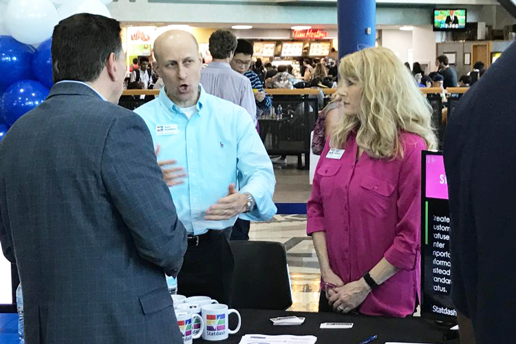 Mark Nusbaum, left, and Pam Nelligan, co-founders of Statdash, talk about their product during the entrepreneurial demos at the UB Entrepreneurs Festival.
