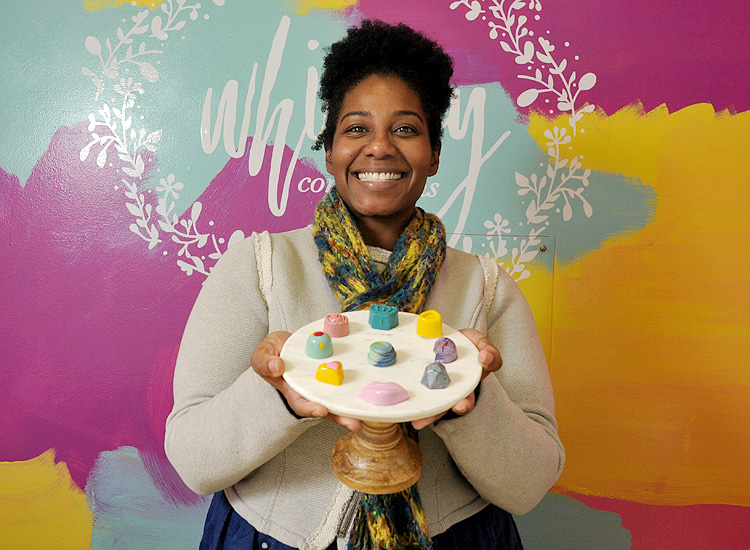 Michele Ogden, the owner of Whimsy Confections, with some of her artistic chocolates.