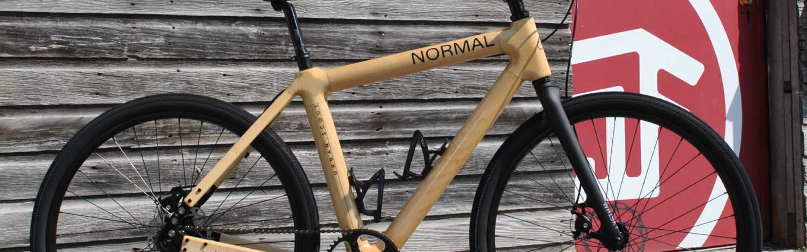 Normal Bicycles are constructed from multiple layers of glued wood veneer, creating a wood composite as strong as fiber or steel. <span class='image-credits'>Normal Bicycles</span>