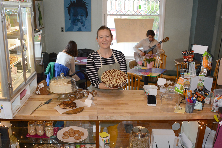 Jessamine Daly-Griffen, owner of Om Nohm Gluten Free, holds one of her creations at her Temple Street shop.