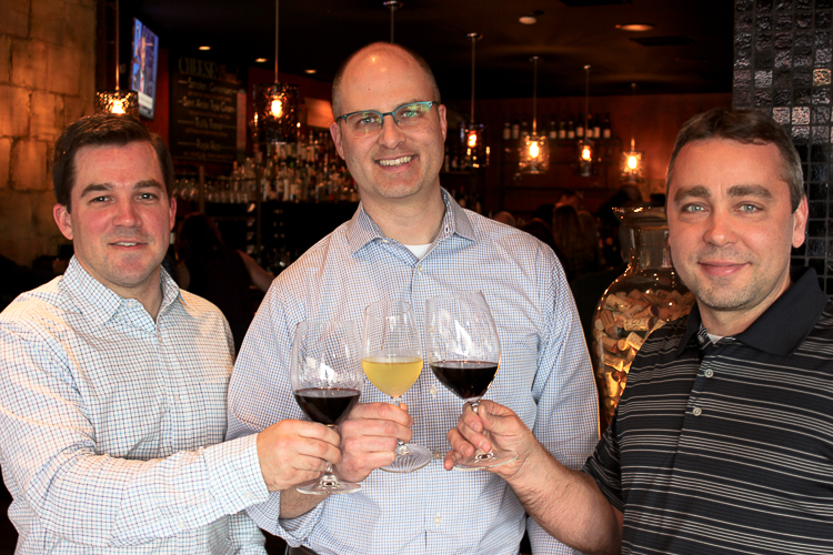 OpenBottle founders Dan Roycroft and Scott Steffan and technical director Ryan Rosiek toast to a successful tasting.