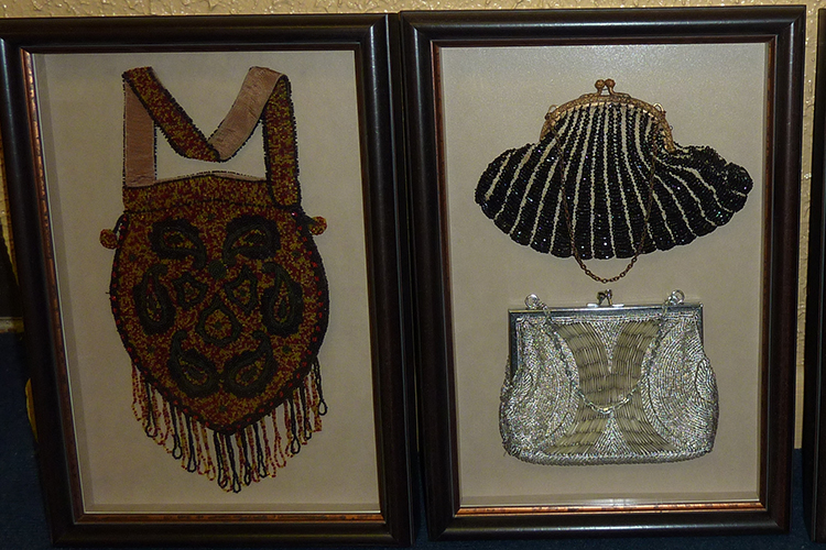 Purses on display, courtesy of Picture Your Walls, a custom frame shop, art gallery, and wholesale and commercial supplier of art and art supplies in Hamburg, N.Y.