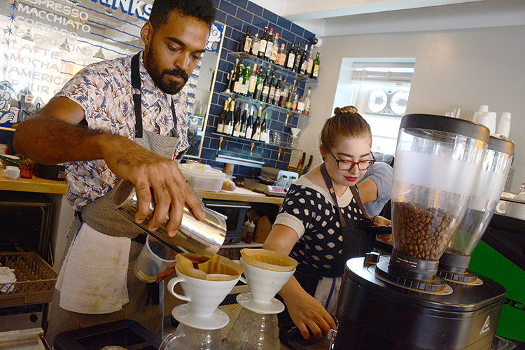 Remedy House employees Sami Tucker and Robin Carman whip up gourmet expresso and macchiato at the café, located at Rhode Island and West Utica streets.