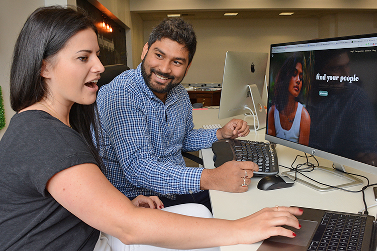 RepHike CEO Shashank Roy and COO Olivia Goldstein work at their Cayuga Drive headquarters.