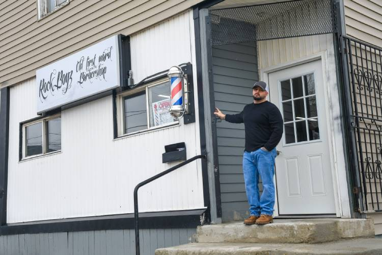 Rocklin stands outside of his shop, located on the corner of Hamburg Street and O'Connell Avenue. The shop opened in December 2018.