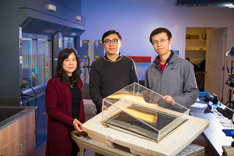 Sunny Clean Water co-founders Zongmin Bei, UB senior research support specialist in engineering, and Qiaoqiang Gan, UB associate professor of electrical engineering, with UB Ph.D. graduate Haomin Song, the company's chief technical officer.
