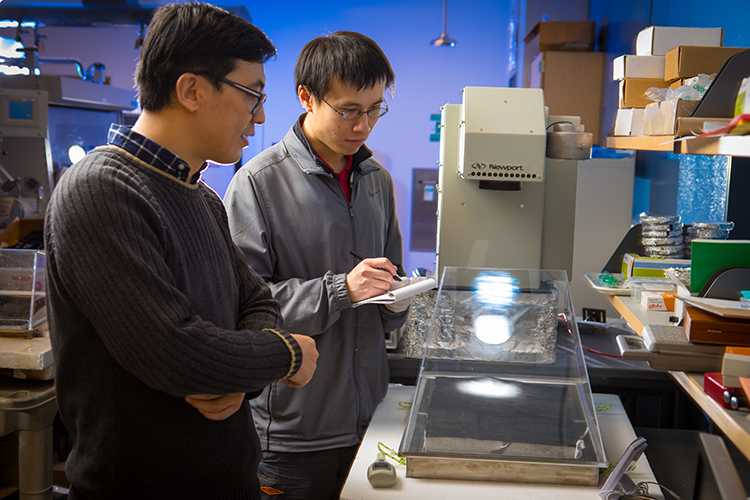 Sunny Clean Water co-founders Qiaoqiang Gan and Haomin Song in the research lab in UB's Davis Hall.