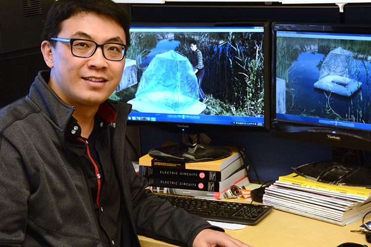 Qiaoqiang Gan, associate professor of electrical engineering at the University at Buffalo, is one of the founders of Sunny Clean Water, which produces a solar-powered water purification device.