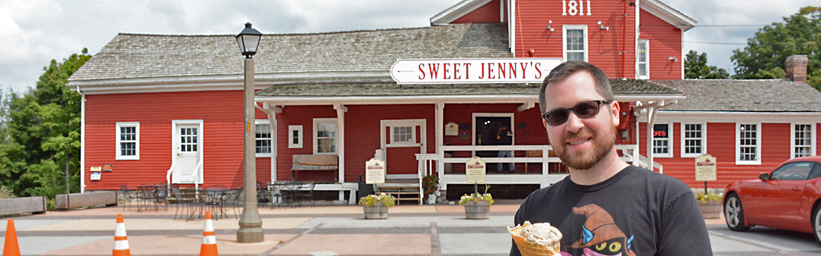 Howard Cadmus stands outside of his popular confection and ice cream shop. Built in 1811, the building originally operated as a saw mill.
