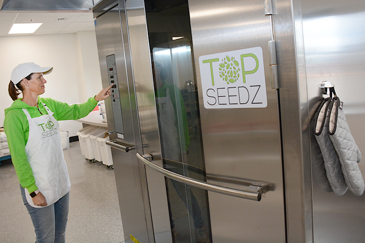 Top Seedz owner Rebecca Brady checks the temperature of her state-of-the-art Baxter double rotation oven at her new baking facility in Cheektowaga.