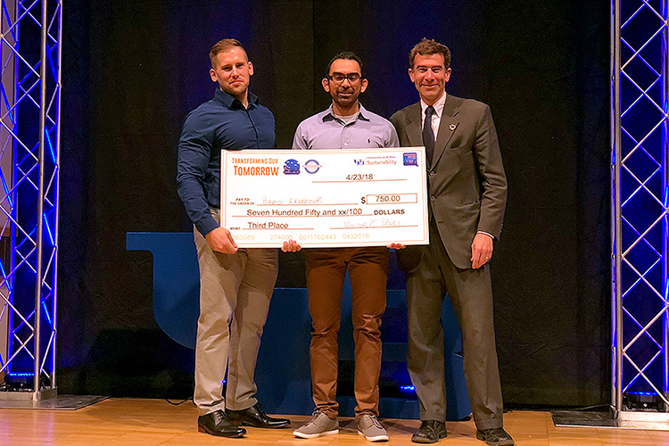 UB Ph.D. candidate Hamid Khakpour Nejadkhaki accepts an award in UB's Transforming Our Tomorrow clean energy pitch competition for his design of a more aerodynamic and efficient wind turbine blade.