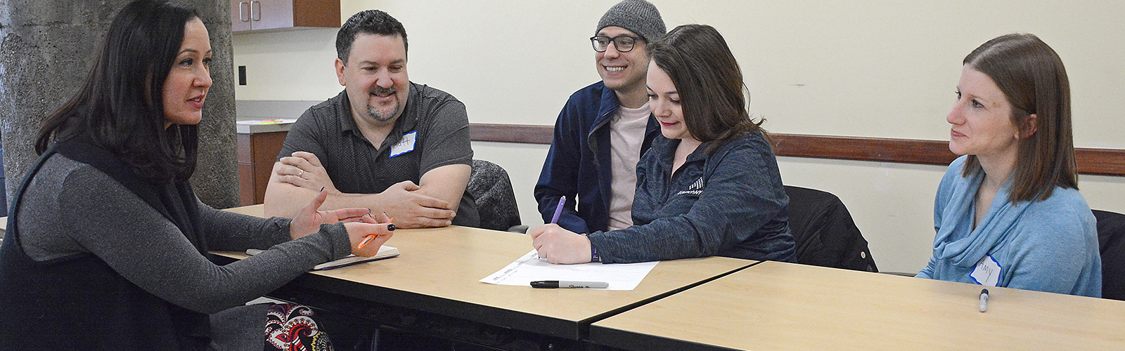 Hadar Borden with WNY Prosperity Fellowship program alumni Matt Coia, Phil Schneider, Celine Keefe, and Amy Monin. Fellows are given scholarships and internships to assist them in gaining experience in their intended professions.