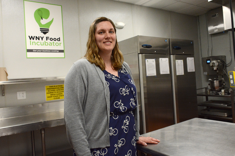 Amanda Henning, agriculture and food systems educator for the Cornell Cooperative Extension, stands in the WNY Food Incubator kitchen in Lockport, N.Y.