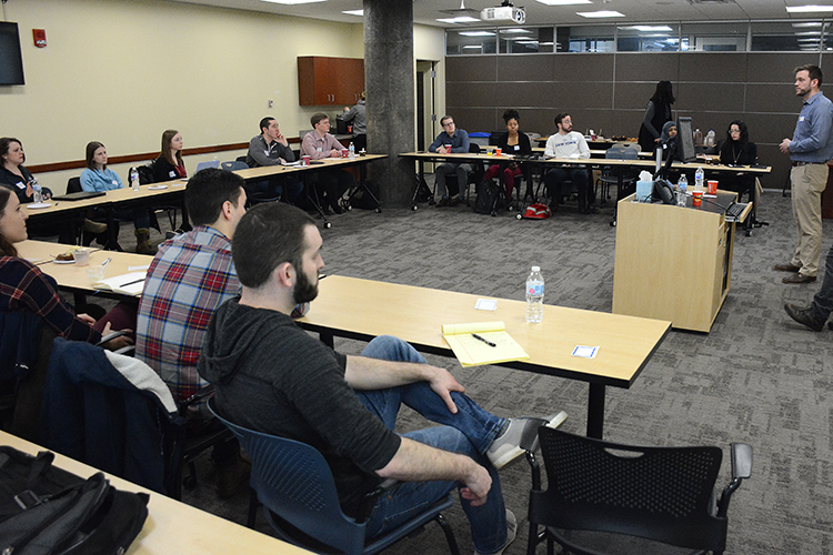 WNY Prosperity Fellowship alum Aaron Krolikowski leads a discussion at a recent alumni event.